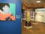 On the left, there is a very valuable Dorothy Hamill painting by Andy Warhol- part of a sports series commissioned by Richard Weisman; one of Andy's friends. Acrylic silkscreen on canvas. In the background, Dick Button's Olympic team coat from 1952 Oslo and Sarah Hughes free skate costume from 2002 can be seen.