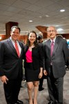 Troy Goldstein, Sarah Hughes and Ron Hershberger take time to pose for a photo before the festivities.