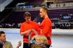 U.S. Figure Skating athletes Alexander Johnson and Nick Traxler hand out raffle tickets.