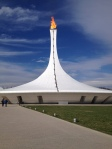 The Olympic Flame shines brightly on another spring-like day.