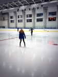 Belbin and Abbott on the ice filming for NBC.